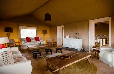 The beautiful mess tent, with dining and lounge areas warmed by wood burning fires and kitted out with lots of comfy corners adorned with sheepskin.